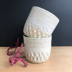 Handmade carved stoneware cup in white hunter and the fox